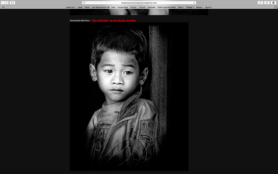 face of vietnam - Boy at the door photo entered in the Black & White Child Photo Awards 2014 received an Honourable Mention.