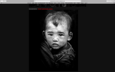 face of vietnam - Ha Nhi boy entered in Black & White Child Photo Awards 2014 received an Honourable Mention and was used on the Front Page for the next Competition.