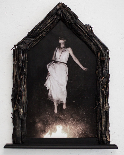 Broken Sundowns - Fire to Wind (2015) from the Eight Stages of Dissolution series. Photograph with handmade frame embellished with bushfire sticks and leaves.