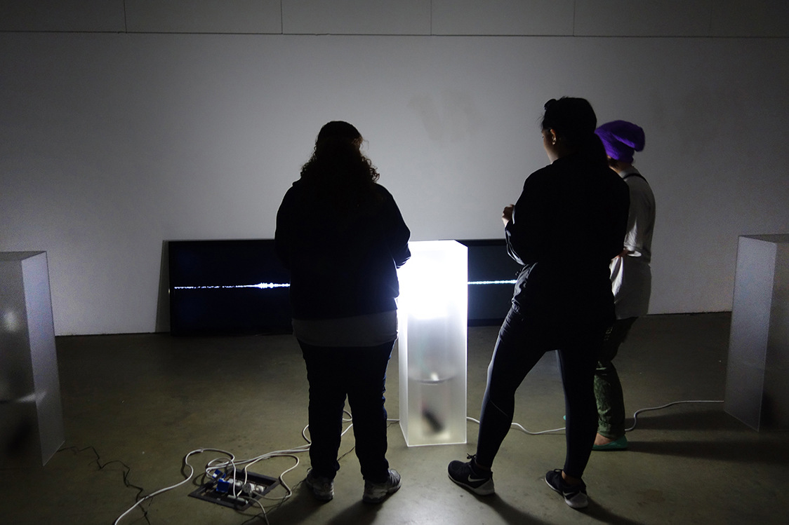 Cameron Rey - Matter: Air Contact, 2014. Acrylic lightboxes with sensors. TVs visualizing sound made in space.