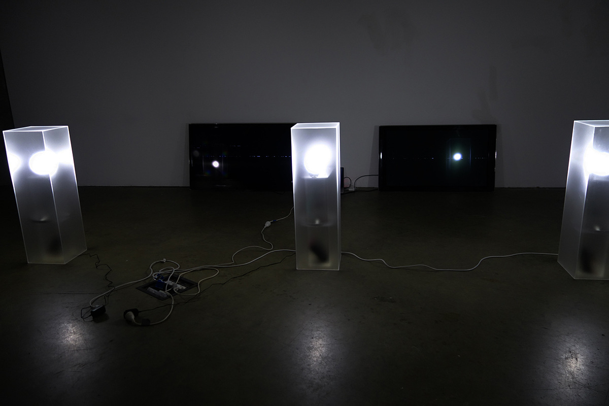 Cameron Rey - Matter: Air Contact, 2014. (Installation view with sensors off). Acrylic lightboxes with sensors. TVs visualizing sound made in space.