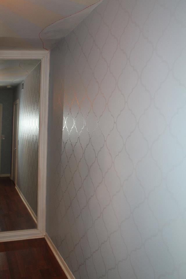 Bespoke Art by Liisa Garceau - A guest room accent wall. Instead of using wallpaper, we decided to paint on the design. Painting onto the walls in many cases is a great alternative to wallpaper. It is easier to change in the future,and when one is ready for a change, they can just paint directly over it,