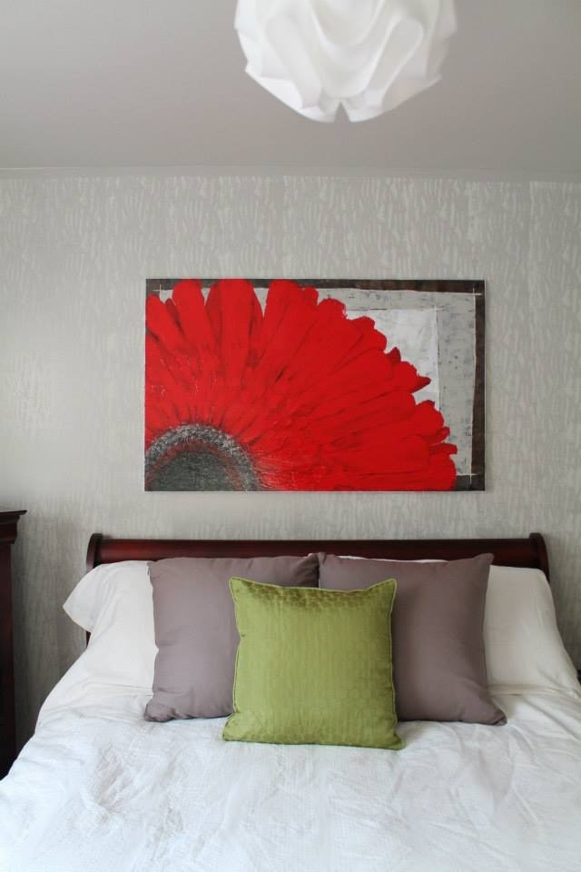 Bespoke Art by Liisa Garceau - After picture of the bedroom. The accent wall design matches the design on the drapes. My client also wanted to have red in the room on a focal painting, so I painted an abstract Gerbera daisy (her favourite flower) and used the same colours in the background from the walls of the room.